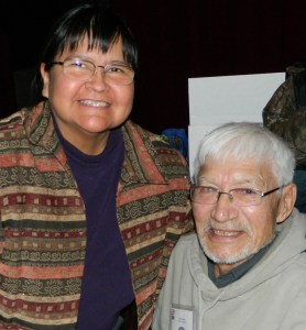George Attla II was recently at an Alaska Sports Hall of Fame event where he signed autographs for new and old fans. Marlene Watson (Navajo) is a new fan. Photo by Angela Gonzalez