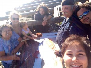 Courtney Agnes (bottom right) works with her family and friends in Tanana . Courtesy photo