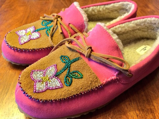 I sewed beaded moose skin on Land's End Kids slippers. Photo by Angela Gonzalez