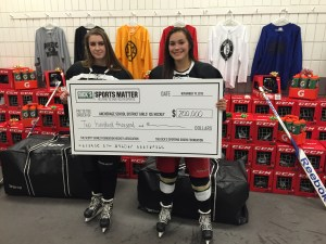 Dick's Sporting Goods Foundation donates to hockey in Anchorage. Amber Steinhilpert is at right. Courtesy photo