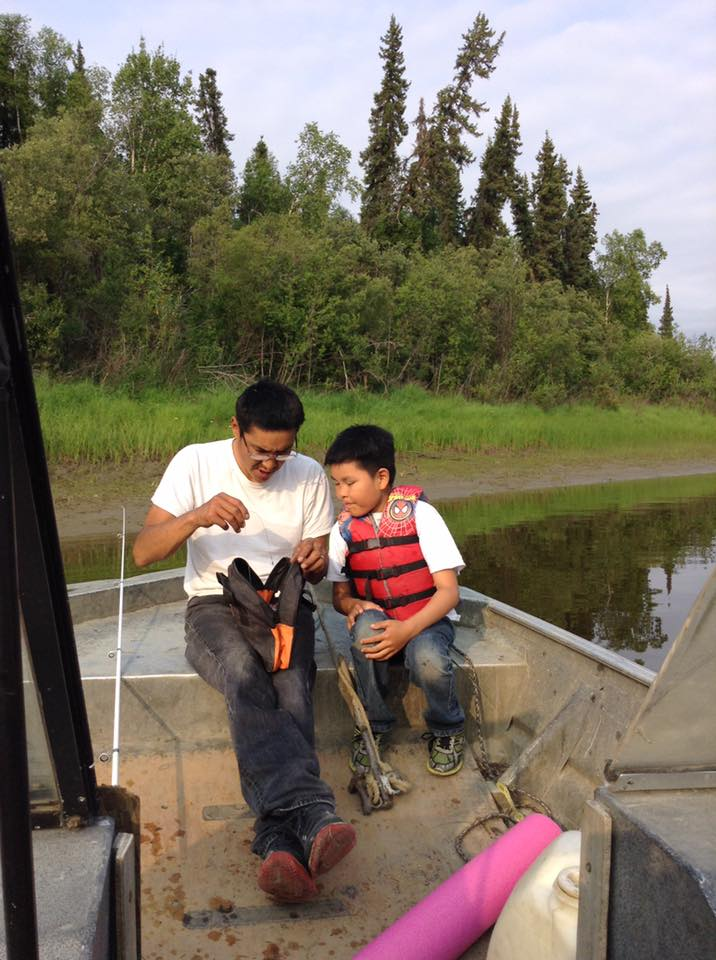 John Williams teaching his son, JJ, to fish along the Koyukuk River. Photo by April Williams