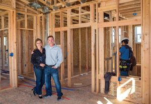 Adam and Kimberly Fels inside their newly framed home. (Photo: Timothy Seibert).