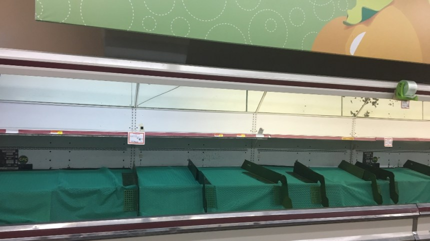 aftermath of hurricane maria - empty produce shelves at selectos