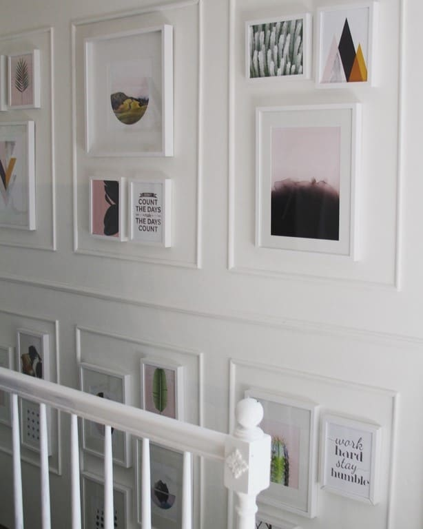 Stairs Decor- final reveal! I did a makeover on my stairway with pictures, paint, and DIY molding. The result is a light and bright design. The side of the staircase has the cutest modern gallery wall. I hope this makeover with fresh stair treads and a runner gives you inspiration and ideas for redoing your space!