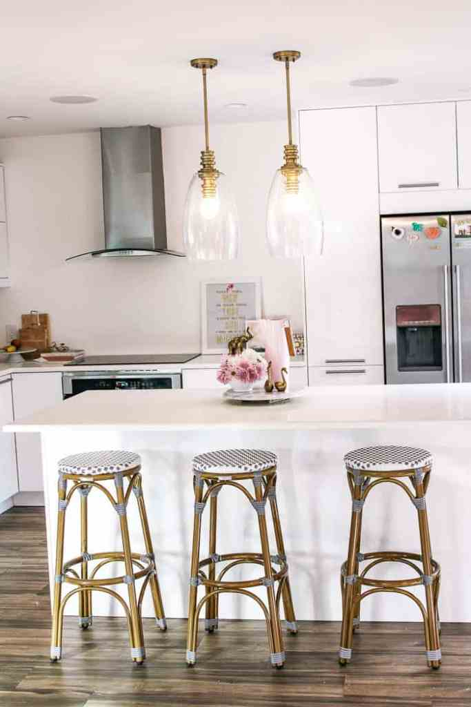 how to choose the perfect light fixtures for your home. Whether you're looking for a light to hang from the ceilings of your dining room, kitchen island, bathroom, hallway, entry, bedroom, or living I'll give you tips to finding one you love. I even have a free quiz written by an interior designer so you can find the perfect products- chandeliers, sconces, flush mounts, track lighting and more! If you need a light with electrical wiring in your house, this post is for you!