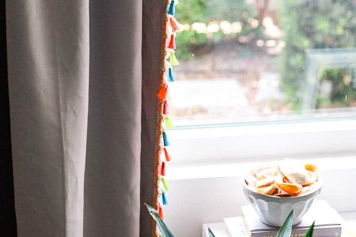 Let the light in. DIY drapes- new sew curtains. Purple drapery with creap colorful tassel trim. Ideas to dress up your window decor
