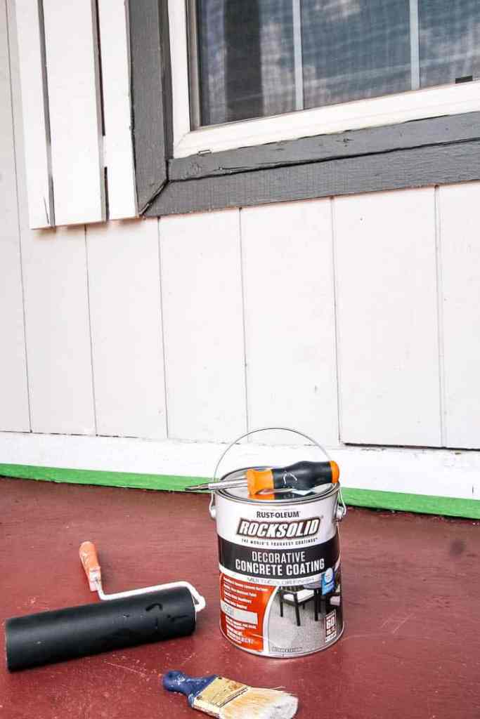 how to paint a concrete porch floor. This is an easy DIY and will add a ton of curb appeal to your house! Perfect for a patio or deck. I did a grey, but you can do lots of colors. I include the exact products I used
