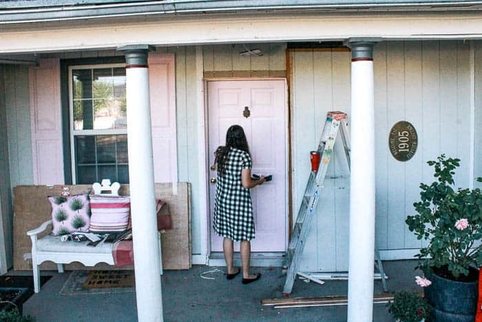 Pink front door. Looking to add some curb appeal to your entrance! I share how I got a new wooden door and gave it a modern makeover with pink paint! You can go with any colors, but isn't there something about a pink door?! Plus tips on porch decorations and layering doormats