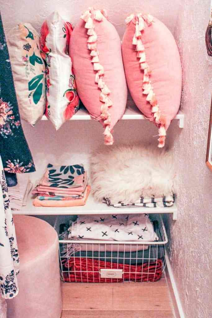 Master closet reveal. Plus how to hang a closet rod on a sloped or angled ceiling or wall. I share 5 options including bracket sources. You'll love this colorful, closet with shoe shelves and a mini linen closet
