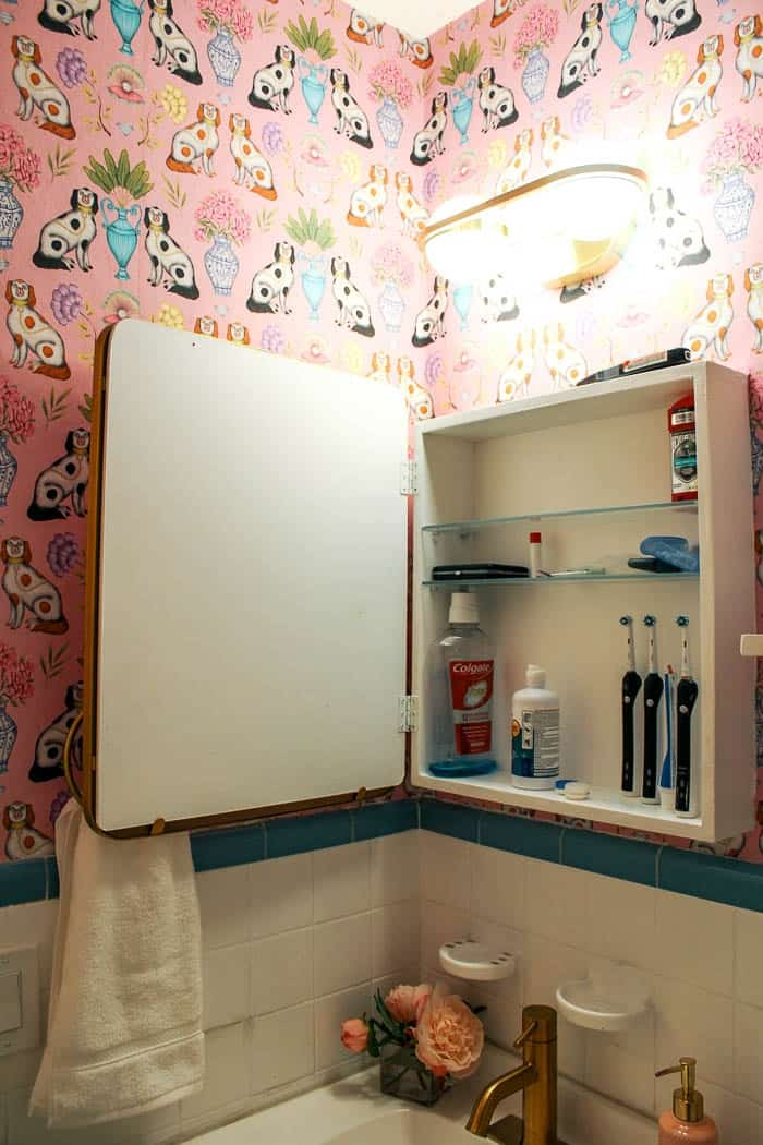 diy medicine cabinet. How to make a medicine cabinet with a new mirror. Ideas for how to makeover a custom and modern piece for hidden bathroom storage. Click through for the tutorial.