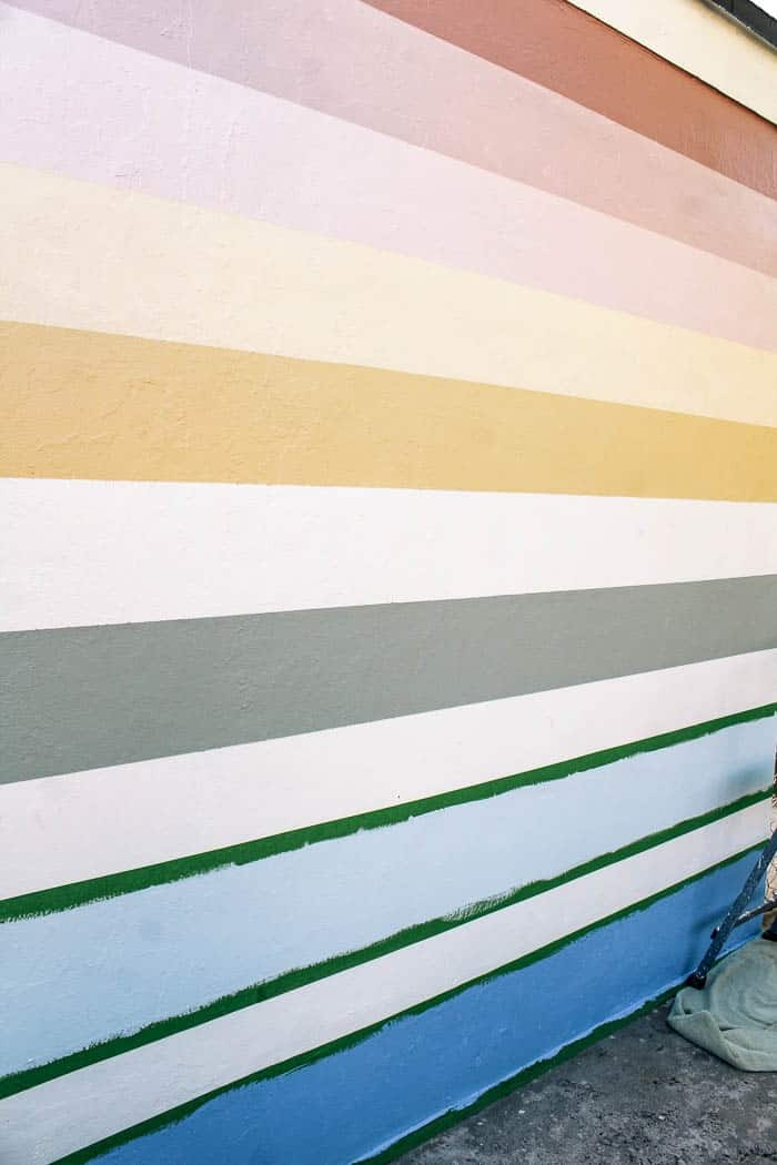 Outdoor rainbow mural diy, How to paint a pastel striped rainbow on a patio wall. This would work in a kids room too and is perfect if you like colors. Easy video tutorial for a painted rainbow with a fun aesthetic