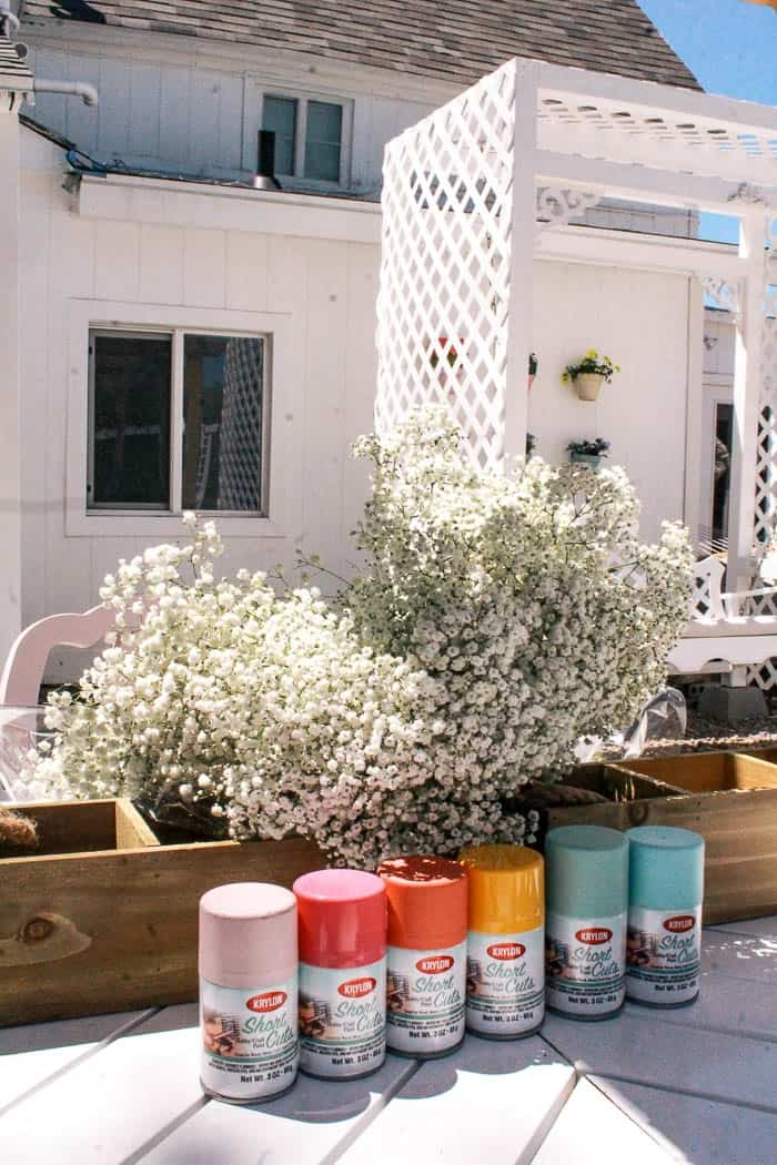 rainbow baby's breath centerpiece. The cost to make a DIY colorful table centerpiece. This would be perfect for a wedding, baby shower, or reception. I share the cost and an easy tutorial for this elegant but ruustic look with soft foliage