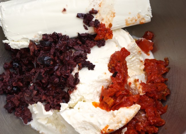 Combine ricotta cheese, goat cheese, sun dried tomatoes, Kalamata olives with ¼ cup grated Parmesan cheese.