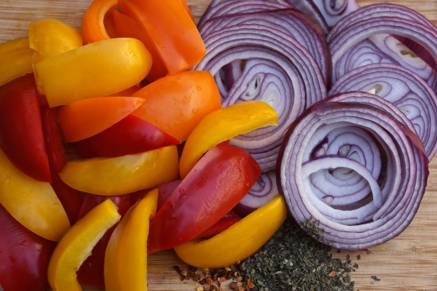 "This recipe calls for 5 large orange, yellow or red bell peppers, cut into 1"" - 1 1/2"" slices and 2 medium purple onions, sliced."
