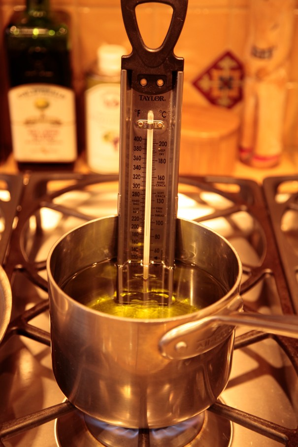 Clip thermometer to side of sauce pan. Add 3 inches of oil. Heat over medium heat.