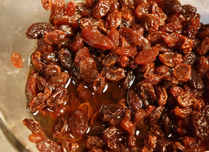 Allow 1 cup raisins to plump in 1/2 cup bourbon for 20 minutes. Drain raisins, reserving bourbon.