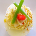 Learn the secrets to cooking perfect hard boiled eggs and get our easy deviled eggs recipe, made with a chive and onion cream cheese filling. So delicious!