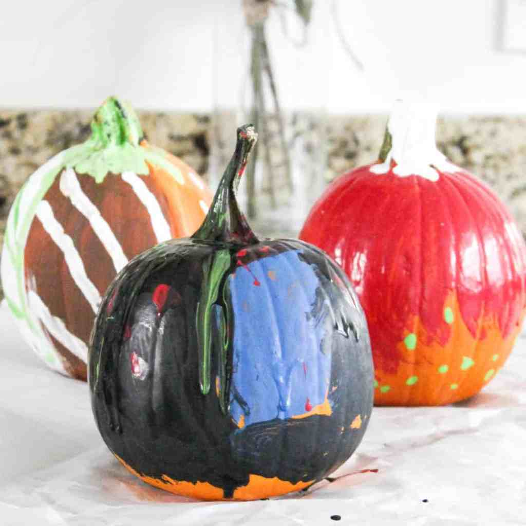 kid painted pumpkin