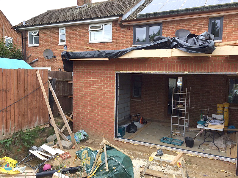 external view on an extension and workman tools