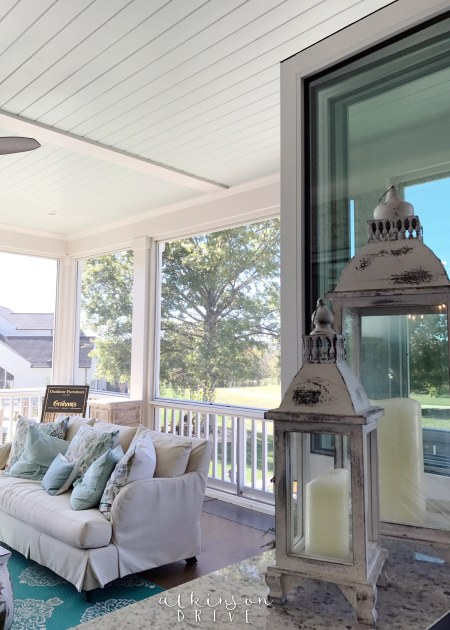 Screened in back porch with a window to serve food /// Woodridge Parade of Homes Tour by Atkinson Drive