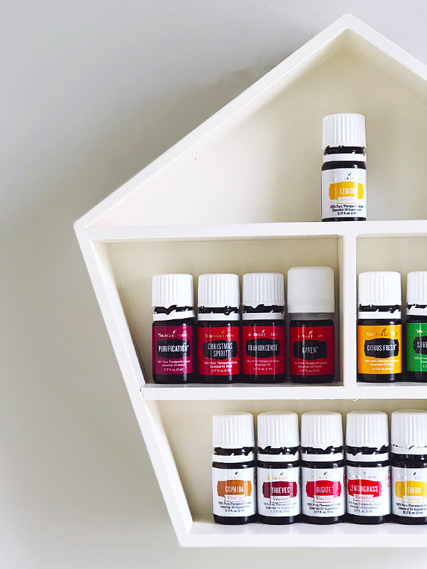 Make this $5 DIY oil shelf in just one day for your growing essential oils collection!