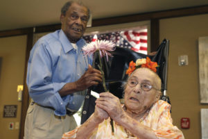 Gertrude Weaver, right, talks with her son Joe Weaver, Thursday, July 3, 2014 at Silver Oaks Health and Rehabilitation Center in Camden, Ark., a day before her 116th birthday.
