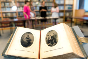 5/07/15 Students research lost Special Collections' photo album.