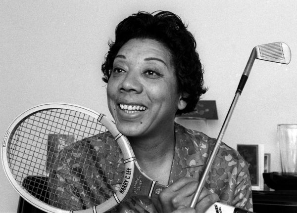 ** FILE ** Althea Gibson, shown in her East Orange, NJ. home in this 1968 file photo, died at the age of 76 on Sunday, Sept. 28, 2003. Gibson was a self-described ``born athlete'' who broke racial barriers, not only in tennis but also in the Ladies Professional Golf Association. She even toured with the Harlem Globetrotters after retiring from tennis in the late 1950s. (AP Photo/Marty Lederhandler, file) ORG XMIT: NY151