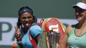 Serena Williams, left, jokes around behind Victoria Azarenka, of Belarus, after Azarenka defeated Williams in a final at the BNP Paribas Open tennis tournament, Sunday, March 20, 2016, in Indian Wells, Calif. Azarenka won 6-4, 6-4. (AP Photo/Mark J. Terrill)