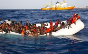 Migrants sit in a rubber dinghy during a rescue operation by SOS Mediterranee ship Aquarius off the coast of the Italian island of Lampedusa in this handout received April 18, 2016. SOS Mediterranee/Handout via REUTERS