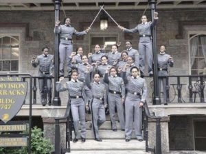 Members of the U.S. Military Academy's Class of 2016 pose for a photo with their fists raised in front of their barracks.