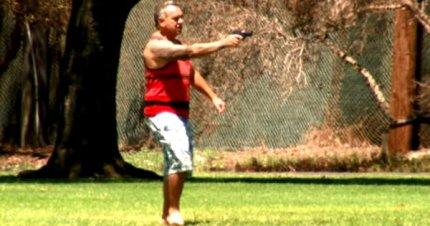 white man with gun