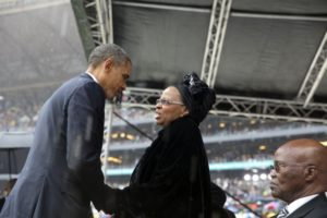 US President Barack Obama greets Graça Machel at the memorial service for her late husband Nelson Mandela, Johannesburg, 2013