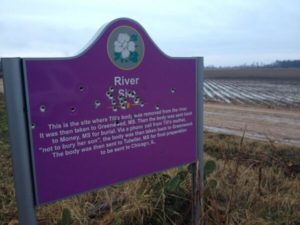 Vandalized sign marking the spot where Emmett Till's body was found. Image courtesy of Christopher Hooks.