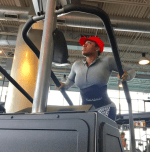 Singer Fantasia using the machines for cardio and toning legs.
