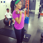 Actress La La Anthony doing bicep curls with weights.