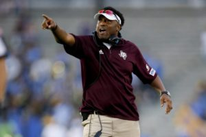 Kevin Sumlin gestures during an NCAA college football game