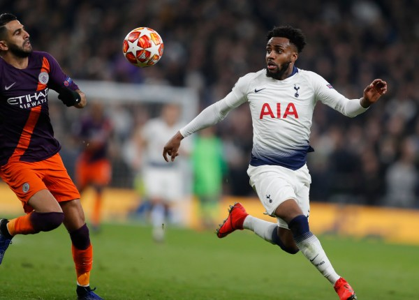 Manchester City's Riyad Mahrez, left, challenges for the ball with Tottenham's Danny Rose during the Champions League
