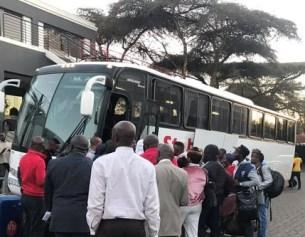 Nigerians boarding buses