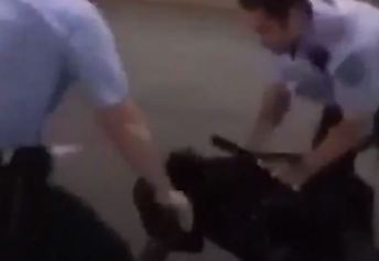 Cop hits Black man with flashlight