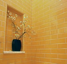 There's no need to leave a windowless powder room in the dark. If installing a skylight isn't an option, color is key. Buttery yellow subway tiles give this small space a sunny disposition. The shallow display niche cleverly maximizes the space that a protruding shelf would have eaten up.The Haralson Group, (404) 320-0481