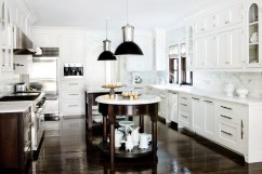 21) Summerour & Associates Architects designed two islands for this kitchen—one square and one round.