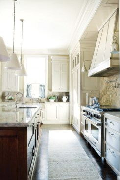 99) Led by Matthew Quinn, Design Galleria Kitchen & Bath Studio mixed stone, metal, wood and painted finishes to create a modern feel.
