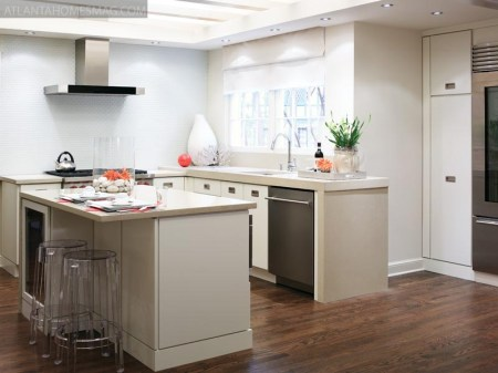 HammerSmith renovated the small kitchen by replacing a 1980s design with white, clean-lined cabinetry and a glass tile backsplash, simplicity being key to its design success.