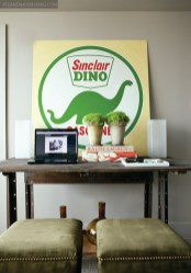 """The condominium""""s den earned the curious addition of a Sinclair Dino sign."""