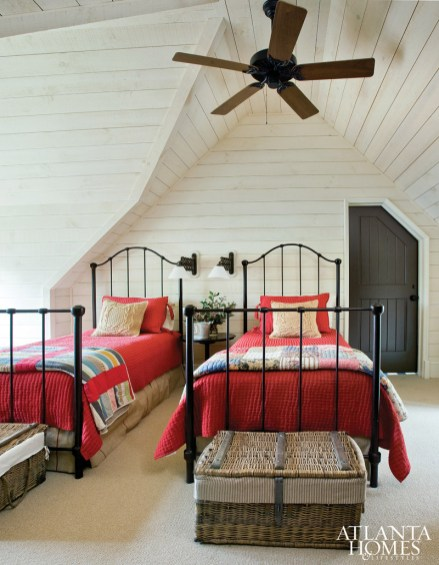 All-American style reigns in the guest suite, where a pair of iron twin beds is topped with cheery red coverlets and quilts.