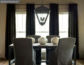 The moody dining nook, open to the living area, is a quaint place to gather for meals.