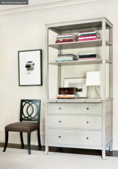 Pieces in the collection include a sideboard and slipper chair; a lounge chair with pull-out tray; an adjustable bookcase and side chair; and a round table and upholstered bench. The signature finish of the line is a walnut stain. Pecan and taupe are other stain options, and the collection includes two painted finishes, as well: stone (a light gray) and truffle (a mix between black and brown).