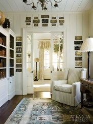 The library door is framed by antique brass shipping stencils found in the owner's family home. The stencils, labeled New York, Boston, Georgetown, Delaware and Chicago, date back to 1830, and bring a sense of history into the space.