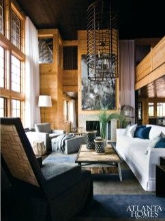 """In the living room, a Belgian-inspired sofa by Dmitry & Co. """"sits like a barge in the middle of a river,"""" says designer Susan Ferrier, providing ample seating for guests. Silk pillows in shades of deep blue and silver add some shimmer to the sofa's Harmony White linen-and-cotton upholstery by Calvin Fabrics."""